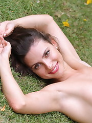 Jazz flaunts her sexy body as she strips in the backyard.