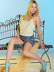 Arya poses in her casual clothes before stripping off to..