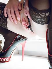 fetish aficionado Natalie Russ dips a finger into her..