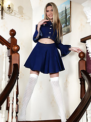 Eva Jude posing in her royal blue long sleeves and..