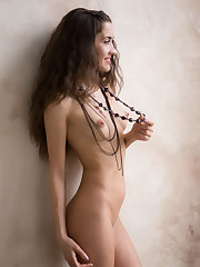 Celina T bares her petite body and meaty pussy as she..