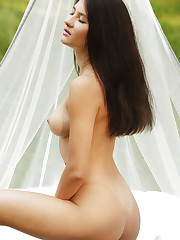 Melisia flaunts her perky tits and tight ass outdoors.