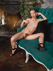 Dennie displays her petite, naked body and hairy pussy on the..