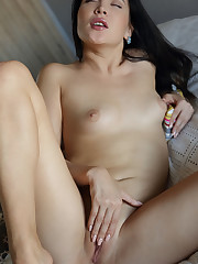 Black Fox strips on the bed as she plays with her sweet..