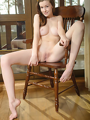 Alluring Emily Bloom displays her creamy, long legs and..