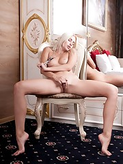Piper A spreads her legs and pussy lips and starts masturbating