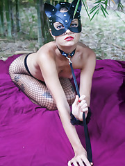 Sexy vixen Jacinta B is masked and leashed in the woods in..