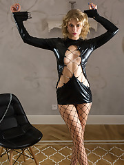 Elza A bares her fishnet stocking as she bares her sweet pussy.