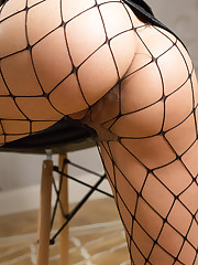Elza A bares her fishnet stocking as she bares her sweet..