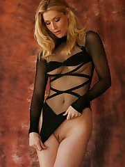 Emma shows off her dark side in a see thru black teddie