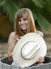 Cowgirl boots and a cowgirl hat Ashley loves to show off..