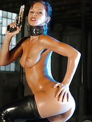 Gorgeous model Susana Spears plays with her pistol