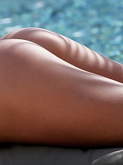 peels off her green top and bottoms poolside