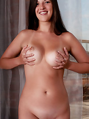 Cute and youthful Natalya A shows off her round, cuppable..