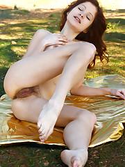 Emanuelle bares her creamy body, pink nipples and sweet pussy..