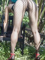 Sweet Julie bares her fishnet stockings as she bares her..