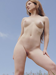New model Nadya E flaunts her creamy body and smooth pussy..