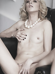 Classy babe Lola S displays her delectable pussy on the..