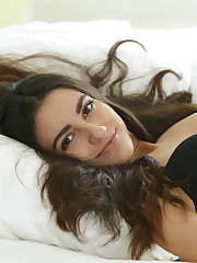 Cira Nerri strips on the bed as she flaunts her petite body.