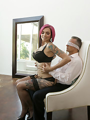 Decked out in a leather dress, Anna Bell Peaks seduces..