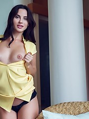 Jasmine Jazz performs a slow striptease of her yellow..