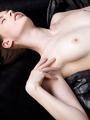 Muslan bares her nubile body with erect nipples and pink..