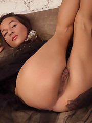 Bound and blindfolded Kenya spreads her legs to show her..