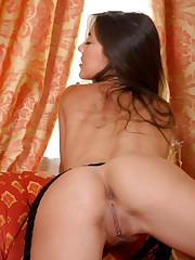 Lorena B teases and seduces in the couch, playing with..