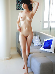 Black-haired seductress Malena posing and lounging naked..