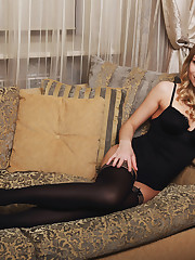 Lucy Heart spreads her legs in the couch and starts..