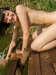 Black MO strips by the river baring her perky tits and..
