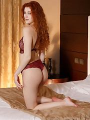 Redhead Adel C poses in her maroon lace lingerie before..