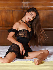 Sizzling hot Lorena B pulls down her lacy black lingerie..