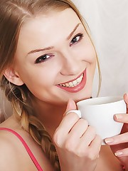 Lucy Heart enjoys her morning coffee before masturbating..