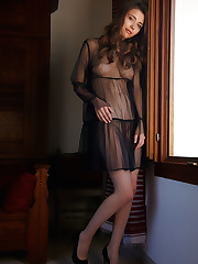 Mila Azul fondles her large breasts and strokes her clit