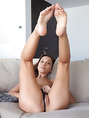 Sabrisse A spreads the lips of her trimmed pussy