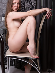 Mika A sensually poses on the chair as she bares her..