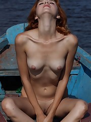 Redhead Viky C bares her tanned body as she poses on the..