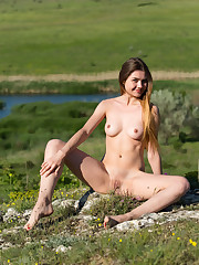 Top model Georgia strips on the grassy field baring her..