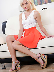 A miniskirt shows off Eliza Jane's long legs, and when she..