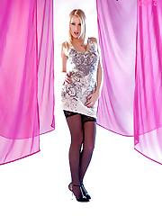Teena, a very tall russian beauty stripping in studio!