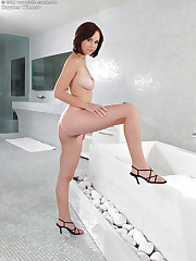 Busty brunette takes a bath