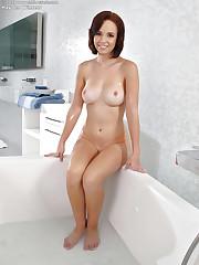 Busty brunette takes a bath