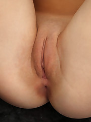 Tiffany flaunts her smooth, plump pussy in front of the..