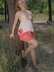 New model Red Cat strips in the woods baring her nubile..