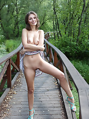 Galina A displays her sweet pussy as she playfully poses..