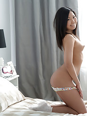 Horny Asian first timer strips off her panties to show her..