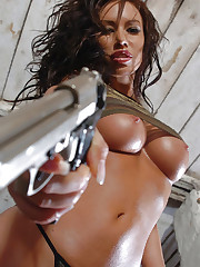Busty girl Kobe Kaige with her silver pistol