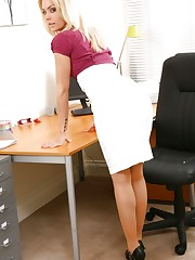 Blonde looks stunning in her office wearing a tight blouse..
