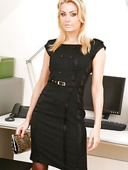 Natasha appears to be the perfect secretary in her black..